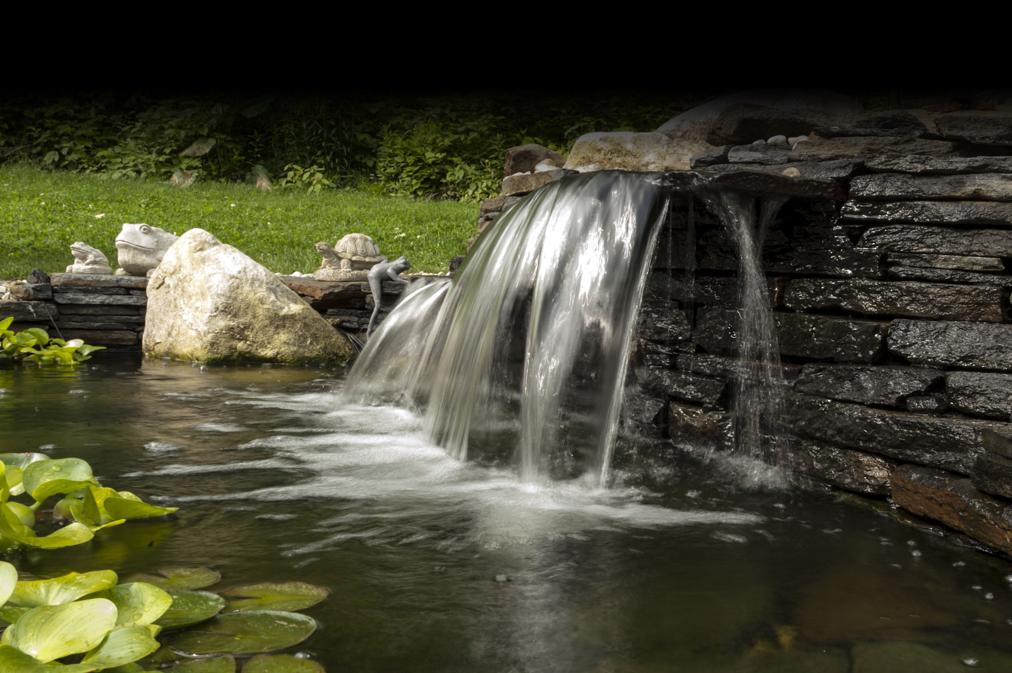 creative stonework and masonry with a waterfall, western massachusetts